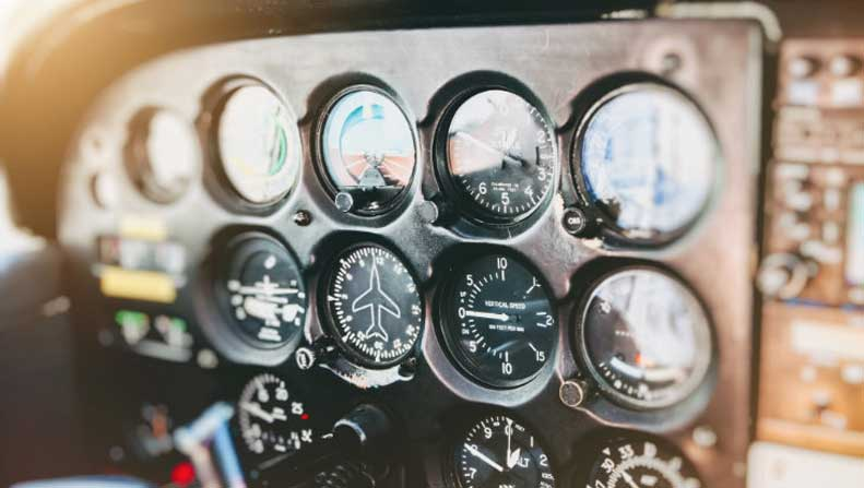 close-up on flight instruments in airplane cockpit, aviation six pack